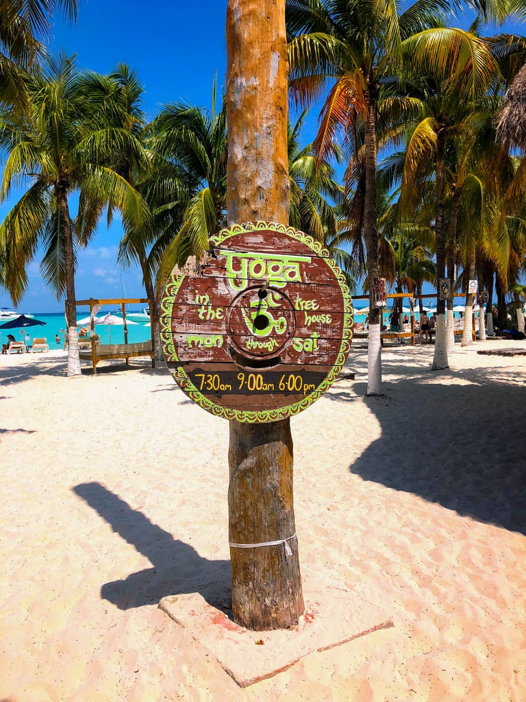 yoga on the beach at playa norte isla mujeres